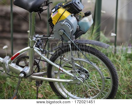 homemade bicycle with a motor of the lawnmower fragment