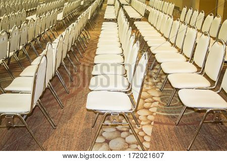Stainless steel leather armchairs arranged in a mess. A straight line For use in conferences and seminars.