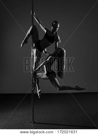 Two Young Sexy Pole Dance Women. Black And White