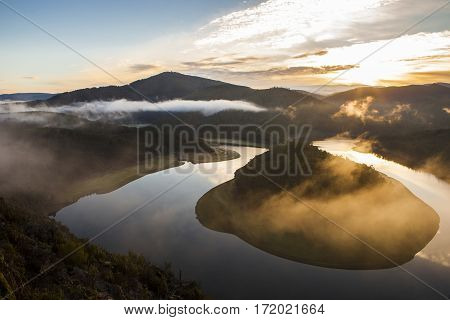 Misty sunrise at Alagon River Meander. This place is called The Melero and is not far from Riomalo de Abajo Hurdes Spain