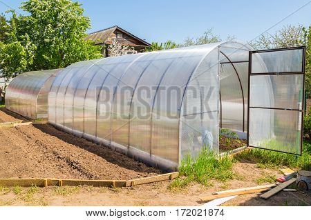 Greenhouse Polycarbonate Arch Type In The Garden