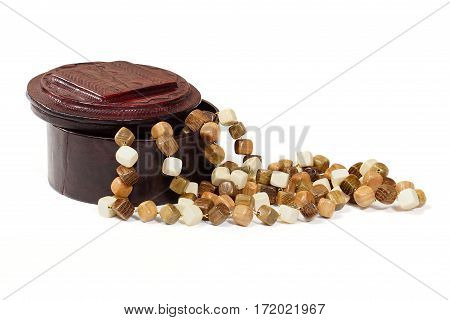Leather jewelry box and wooden beads on a white background. Souvenirs.