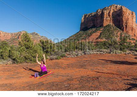 a woman practicing yoga in the red rocks of Sedona Arizona