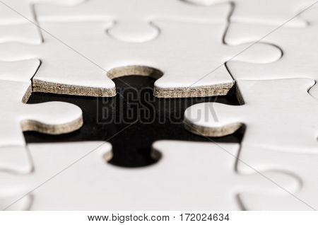 close up of a jigsaw with a piace lacking. problem solving. business.
