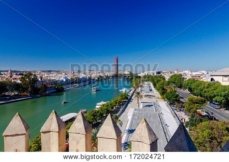 View of urban embankment in Seville along the Guadalquivir river by day. Spain. Andalusia.