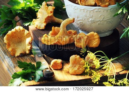 Fresh chanterelle mushrooms on a table .