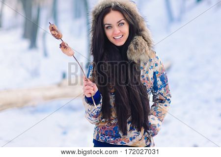 Making a barbecue in winter, Beauty woman in forest