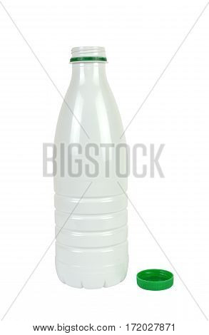 White opened plastic bottle for milk or milky drinks with its green lid beside isolated on white