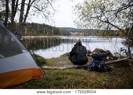 Male Hiker Enjoying The View Of Lake At Campsite