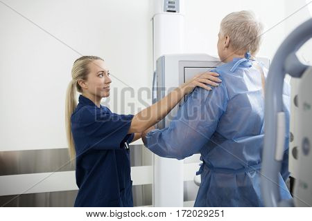 Radiologist Taking Xray Of Mature Man In Hospital