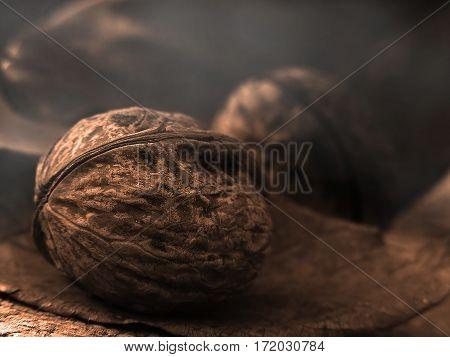 Walnut on wooden desk. Artistic photo of walnut