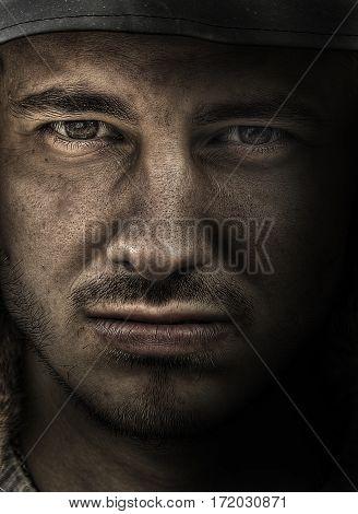Dirty soldier face. Fine art portrait of dessant