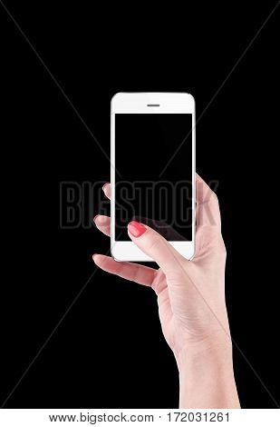 Female Hand holding and Touching a Smartphone isolated on black background. With clipping path