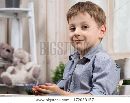 Happy little boy. Bright children's room. Portrait of a child smile emotion