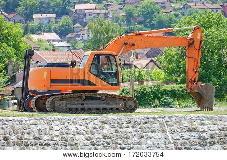 Excavator Digger Machine at Canal Construction Site