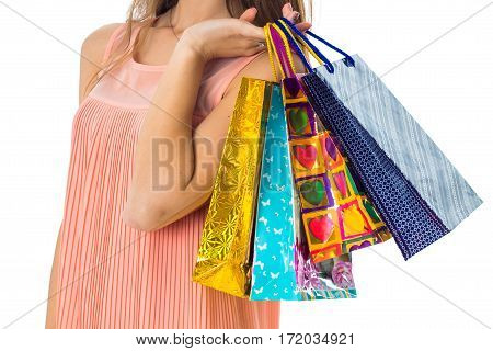 a girl holds in her hand a lot of color bright packages