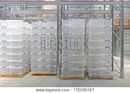 Plastic Boxes at Pallet Rack in Warehouse