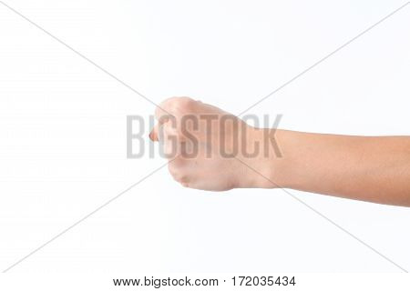 female hand outstretched to the side and showing a fist is isolated on a white
