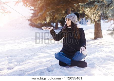 Girl Sit On Snow In Winter Park