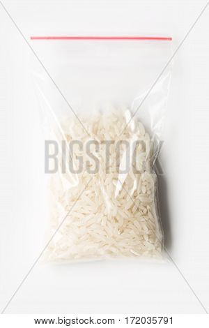 Plastic Transparent Zipper Bag With Half Uncooked White Basmati Rice Isolated On White, Vacuum Packa