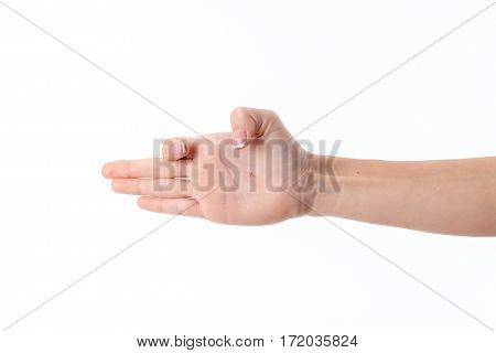 female hand outstretched to the side and showing the gesture with a bent index finger and thumb is isolated on a white
