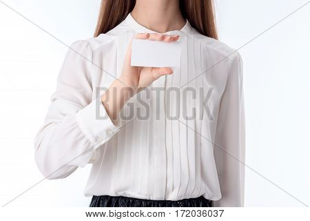 girl in shirt keeps a hand paper leaf isolated on white