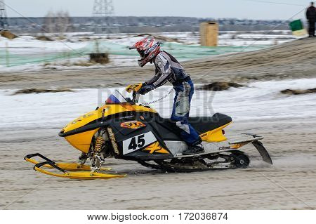 Tyumen Russia - March 08. 2008: IV stage of personal-team Championship of Ural Federal district in over-snow cross-country. Sport racing of ski mobile rider at winter day