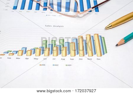 Financial analysis with pen close up .