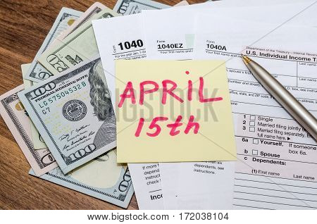Official Usa Tax Form 1040, Calculator, Pen And Dollar And The Day Tax April 15
