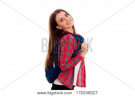 cheerful stylish smart student girl with backpack on her shoulders posing and smiling on camera isolated on white