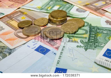 euro banknote with coins - close up