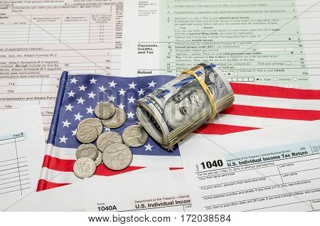Us Federal Income 1040 Tax Return Form With Money And Flag