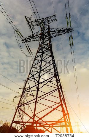 Background of the high-voltage tower in the sunset