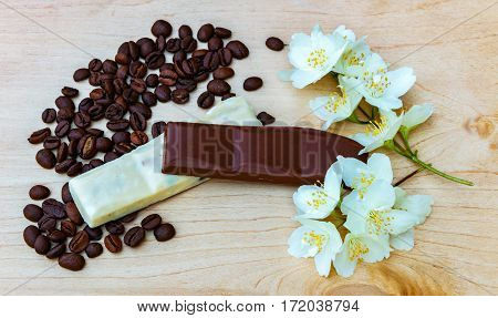Pieces Of White And Milk Chocolate. Jasmine Flowers. Black Coffee