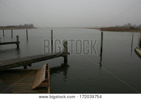 Beautiful grey landscape with fog in Lauwersoog