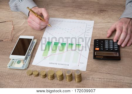 Accounting. man showing finance graph. close up