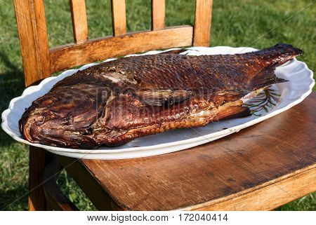 Smoked Carp On A White Plate.