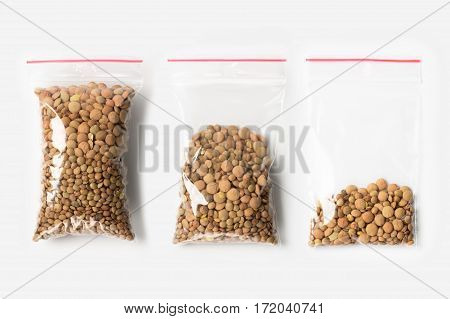 Set Of Three Empty, Half And Full Plastic Transparent Zipper Bag With Lentils Beans Isolated On Whit