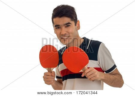 portrait of cheerful sportsman practicing a ping-pong and smiling on camera isolated on white