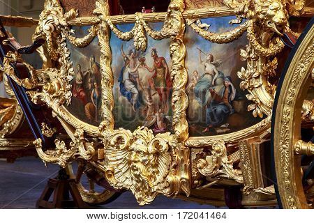 LONDON, GREAT BRITAIN - MAY 17, 2014: This is art fragment of the royal coronation coach in the Royal Mews.