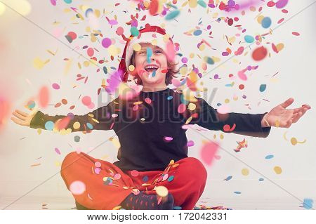 Child celebrating it with confetti the Christmas