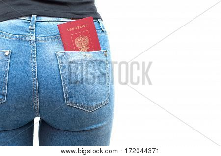 Passport in the back pocket of blue jeans girl