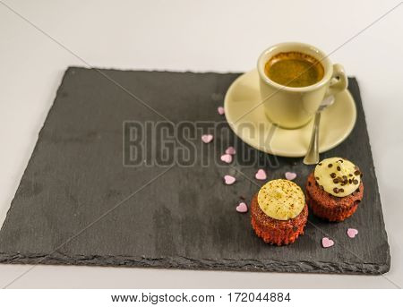 top view on two sweet cupcakesstrawberry and creamy chocolate delicious aroma black coffeelittle violet hearts love dessert