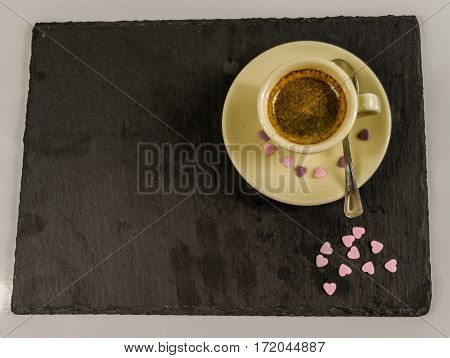 the small black coffee in a cup spilled sweet purple hearts black stone plate love coffee