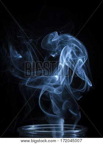 Abstract Blue Smoke Flowing From Vertical Bottle Background