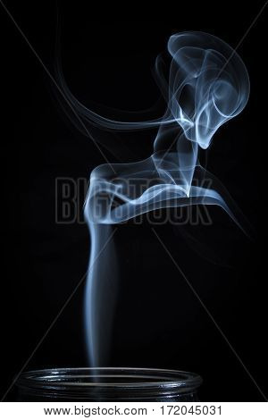 Abstract Fine Blue Smoke Flowing From Vertical Bottle Background