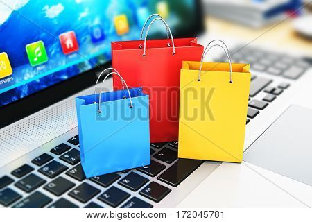 3D render illustration of macro view of the group of color paper shopping bags on modern laptop or notebook computer PC keyboard with selective focus effect