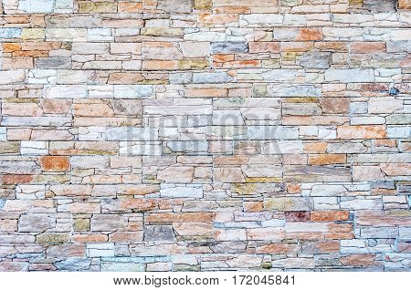 Beautiful modern stone wall background close up