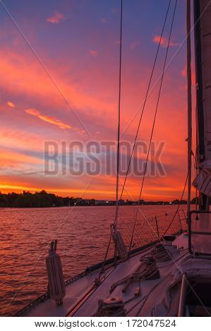 Amazing sunset view from the sailing ship on the Parana river in Argentina. Beautiful colors of sky and water. Vertical