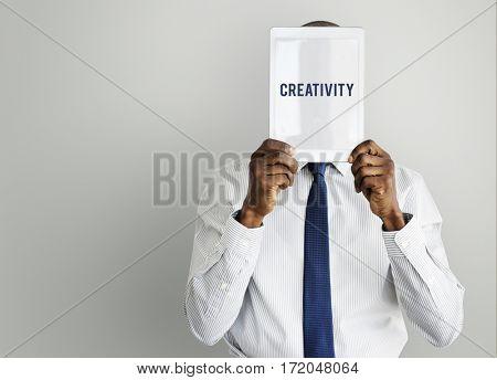 Creativity word tablet on face